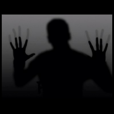 Creepy, dark silhouette of a man