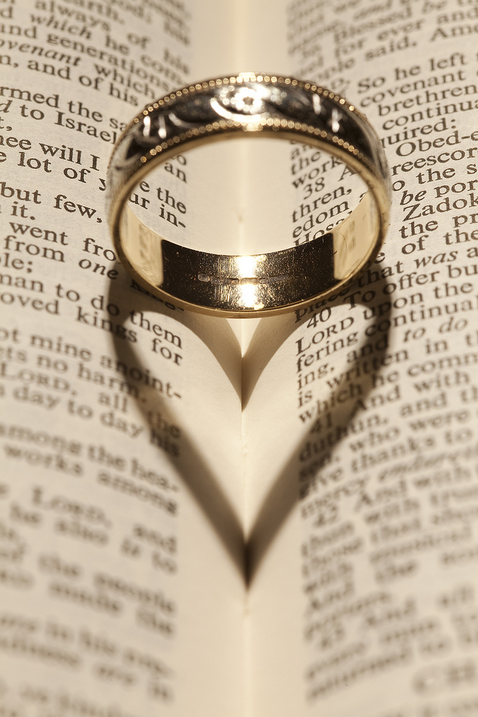 Romantic ring forming a heart on a bible
